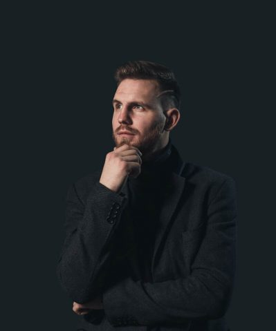 man-in-black-suit-jacket-full-width